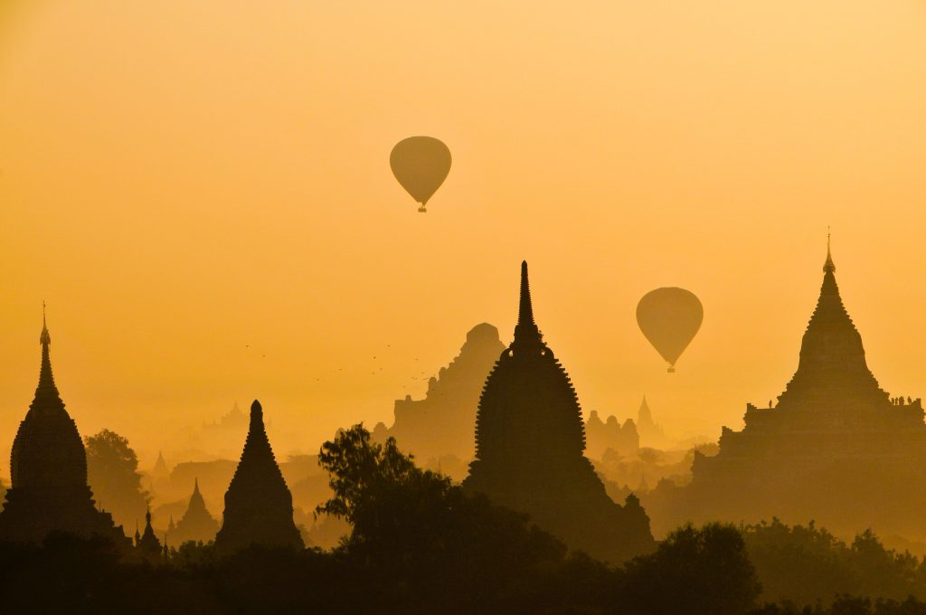 Hot Air Balloons Over Exotic City