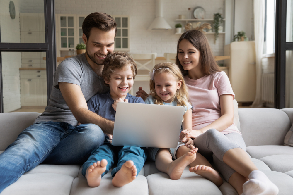 Happy family enjoy fast internet on their computer.