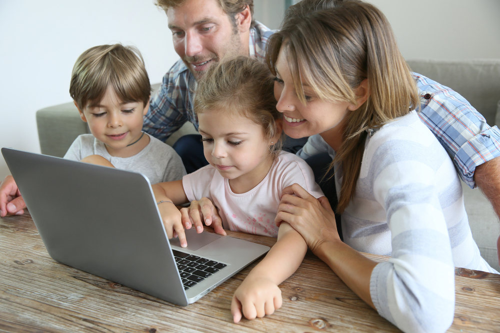 A family using Wahoo Internet on their laptop.