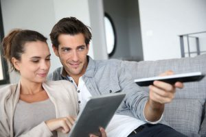 a couple enjoying a viasat internet bundled with television