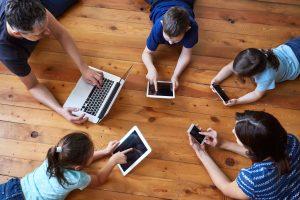 family enjoying viasat internet on multiple devices