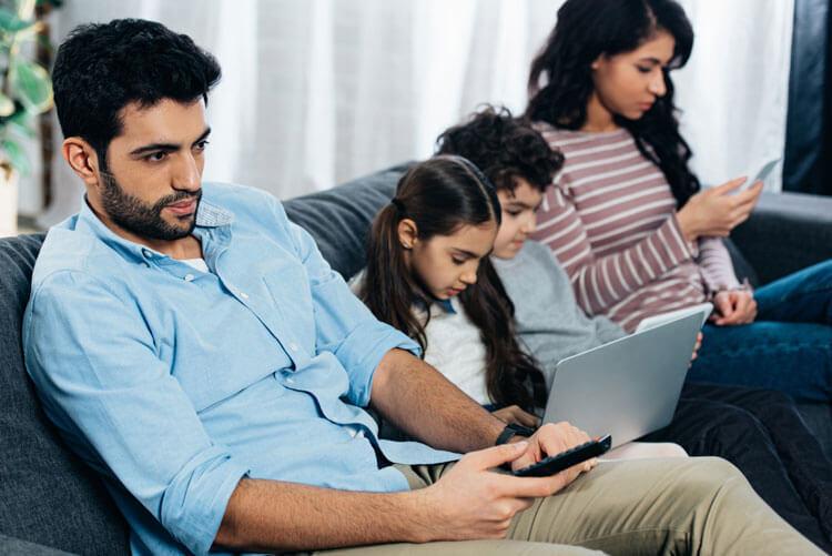 latino family using viasat internet while watching spanish television.